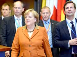 German Chancellor Angela Merkel leaves at the end of the first day of a EU summit in Brussels. EU leaders vowed to set up a banking union during the course of 2013. AFP photo Oct 19: Day in pics