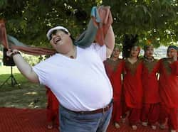 A foreign tourist dancing during a festival in Srinagar on Tuesday. AFP Photo Region in pics