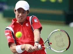 Kei Nishikori of Japan returns the ball to Sam Querrey of the US during their men