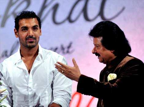 John Abraham with Pankaj Udhas. (Photo/AFP) DAPPER! John Abraham at music launch
