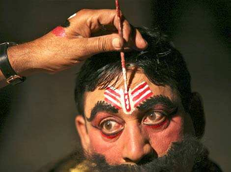 Kulbhushan, 38, a performer, gets makeup applied backstage before performing the role of the demon king Ravan in ramleela as part of Dussehra festival celebrations in Jammu. Reuters Photo Playing out Lord Ram