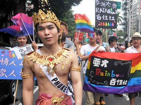 Participants take part in the gay parade in Taipei. Tens of thousands of people from Taiwan