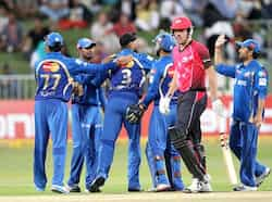 Moise Henriques of the Sydney Sixers walks off as the Mumbai Indians celebrate his wicket during a Champions League T20 (CLT20) match Sydney Sixers vs Mumbai Indians at Sahara Stadium Kingsmead in Durban. AFP Photo Sydney Sixers vs Mumbai Indians