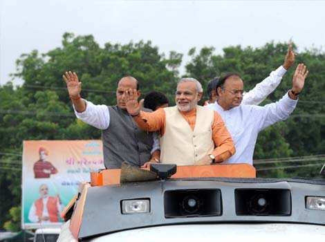 Gujarat state chief minister, Narendra Modi is accompanied by former Bhartiya Janta Party (BJP) president, Rajnath Singh and leader of opposition in Rajya Sabha, Arun Jaitley as he kicks off his month-long Vivekanand Yuva Vikas Yatra at Becharaji town, some 110 kms from Ahmedabad. AFP/Sam Panthaky Modi: man of the moment