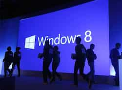 People walk past a display at a press conference unveiling the Microsoft Windows 8 operating system in New York City. AFP photo Windows 8 unveiled!