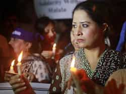 Women hold lighted candles during a rally condemning the attack on schoolgirl Malala Yousufzai. Reuters Praying for Malala