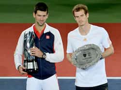 Novak Djokovic holds the winners trophy after defeating Andy Murray during their finals match at the Shanghai Masters tennis tournament in Shanghai. AFP Photo Masters of Shanghai