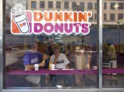 File photo of customers at a Dunkin