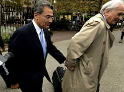 Former head of global consulting firm McKinsey & Co. and former director at Goldman Sachs Group, Rajat Gupta (L) arrives at  federal court  with his lawyer Gary Naftalis in New York. AFP/Timothy A. Clary Jail and shame for Rajat Gupta