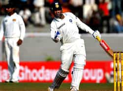 Virendra Sehwag celebrates scoring double century on the second day of the third test between India and Sri Lanka in Mumbai. AFP/Pal Pillai Sehwag