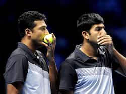 Mahesh Bhupathi and Rohan Bopanna talk between points against Leander Paes and Radek Stepanek during their semi-final doubles match on the seventh day of the ATP World Tour Finals tennis tournament in London. AFP/Glyn Kirk Bhupathi-Bopanna beat Paes-Stepanek