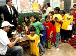 Cricketer Gautam Gambhir gives autograph to the children during a Hindustan Times initiative