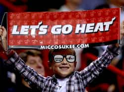 A Miami Heat fan cheers during a game against the Milwaukee Bucks at American Airlines Arena in Miami, Florida. AFP/Mike Ehrmann/Getty Images Nov 22: Day in pics
