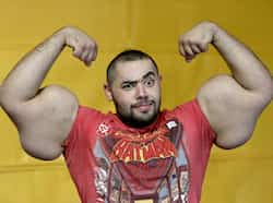 Egyptian body builder, Moustafa Ismail, poses during his daily workout at World Gym in Milford, Mass. Ismail has been given the title of world
