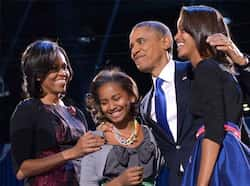 US President Barack Obama accompanied by First Lady Michelle and daughters Sasha and Malia appears on stage on election night in Chicago, Illinois. AFP photo/Jewel Samad Obama