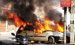 Vehicles in flames at Kalikaman after an incident of violence in old city of Hyderabad. (PTI Photo) Nov 17: Day in pics