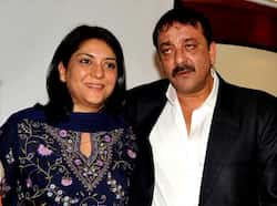 Happy family: Sanjay and Priya Dutt look rather happy in each other