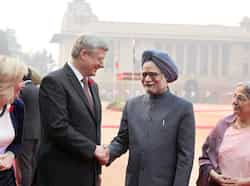 Prime Minister Manmohan Singh shakes hands with his Canadian counterpart Stephen Harper as Harper