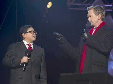 "Actor Neil Patrick Harris speaks with actor Rico Rodriguez (L) from the televison show ""Modern Family"" during the National Christmas Tree Lighting on the Ellipse adjacent to the White House in Washington, DC. (AFP Photo) Dec 7: day in pics"