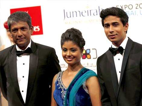 Indian actors Suraj Sharma (R), Shravanthi Sainath (C) and Adil Hussain (L) attend the opening ceremony of the Dubai International Film Festival in Gulf emirate of Dubai on December 9, 2012. AFP PHOTO Photos section of HT
