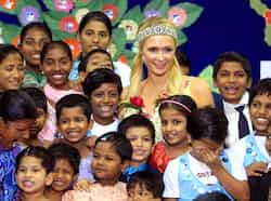 Paris Hilton poses with children from Ashray, an orphanage, during her visit to Mumbai. (AP Photo) Paris Hilton woos India