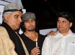Poet, lyricist and scriptwriter Javed Akhtar along with playback singer Sonu Nigam and music director Jatin take part in a candlelight vigil in Mumbai, after the death of a gangrape victim from New Delhi. (AFP Photo) Dec 30: Day in pics
