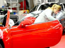 An employee checks a Ferrari tourism car at the end of the assembly line in the Ferrari factory in Maranello. The Ferrari 45 buildings