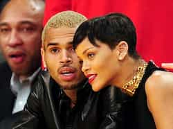 Rihanna (R) and Chris Brown attend a game between the New York Knicks and the Los Angeles Lakers on December 25, 2012. AFP PHOTO Rihanna-Chris Brown too cosy at a basketball game