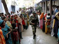 Voters standing in queue during the first phase polling of Gujarat assembly election in Ahmedabad, Gujarat. HT/Arijit Sen Gujarat votes in phase 1