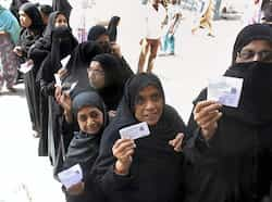 Women voters show stand in a queue to vote at a polling station for the second phase of Gujarat Assembly elections in Ahmedabad. Over 19.8 million voters will decide the fate of 820 candidates including Chief Minister Narendra Modi, who is seeking his third term. (PTI Photo) Voters