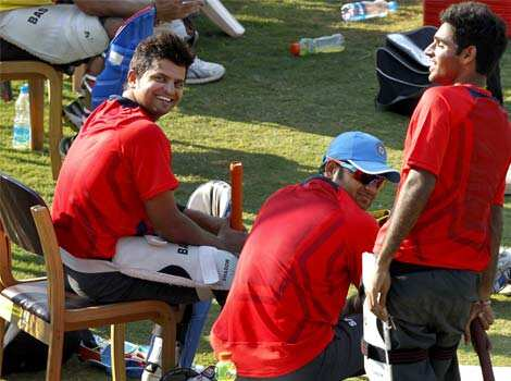 Indian cricket players Suresh Raina and Piyush Chawla during the practice session at Chinnaswamy stadium in Bangalore. HT Photo/Ajay Aggarwal Warming up for Bangalore T20