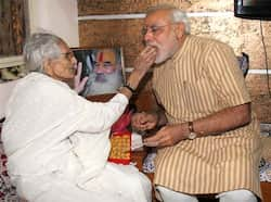 Gujarat chief minister Narendra Modi seeks blessings from his mother after his victory in Gujarat Assembly polls. (UNI Photo) Modi: man of the moment