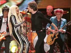 "(L - R)Ronnie Wood, Lady Gaga, Mick Jagger, Charlie Watts and Keith Richards perform onstage during the Rolling Stones final concert of their ""50 and Counting Tour"" in Newark, New Jersey. (Reuters) Who"