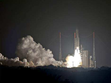 An Ariane 5 rocket carrying two satellites, Skynet 5D and Mexsat Bicentenario, blasts off from the European space centre of Kourou, French Guiana. AFP Photo Dec 20: day in pics