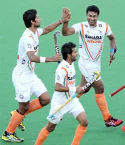 Raghunath Vr of India (R) is congratulated by teammates after scoring against New Zealand during their Pool A match at the Men