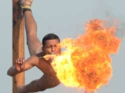 A soldier blows fire as he performs the mallakhamb during an Army Mela (fair) and exhibition at Khasa, some 15 kms from Amritsar. AFP PHOTO/ NARINDER NANU