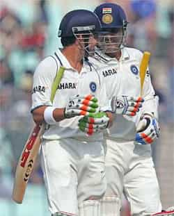 Virender Sehwag and Gautam Gambhir walk off the field after the end of the first session during Day 4 of the 3rd Test Match against England at Eden Garden in Kolkata. PTI Photo 3rd Test, day 4: Ind vs Eng