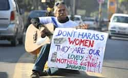 Music director and social activist Kishor Giri sits on a road median, and protests against Delhi gangrape, in Guwahati. AP photo Dec 26: Day in pics