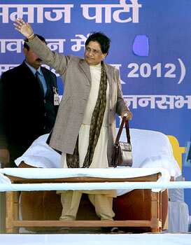 Uttar Pradesh chief minister and BSP supremo Mayawati waves to crowd during an election rally in Barabanki. The state goes to the polls from February 8. PTI/Atul Yadav  Big two in UP battle