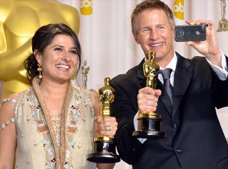 Winners for Best Documentary Shor Saving Face, Daniel Junge and Sharmeen Obaid-Chinoy poses with the trophy in the press room at the 84th Annual Academy Awards. (AFP) Winners: 84th Academy Awards