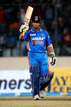 Sachin Tendulkar acknowledges the crowd after scoring fifty runs during the Asia Cup cricket match against Pakistan in Dhaka, Bangladesh. AP/Pavel Rahman India stun Pakistan
