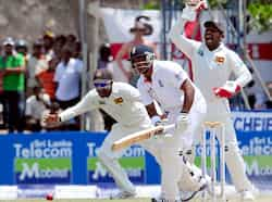 Sri Lankan wicketkeeper Prasanna Jayawardene (R) successfully appeals for a Leg Before Wicket (LBW) decision against England