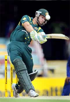 Australian batsman Matthew Wade hits a six from a delivery by Sri Lankan paceman Lasith Malinga in the first international one-day cricket final at the Gabba in Brisbane. AFP Photo/William West CB series 1st final: SL vs Aus