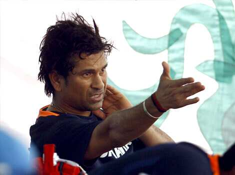 Sachin Tendulkar gestures to his teammates after attending a training session in Dhaka, Bangladesh. India will play Sri Lanka in their first match of the Asia Cup on Tuesday. AP/Aijaz Rahi Team India hits the nets