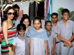 Malaika poses with kids at the event. Multi-coloured Malaika for a cause