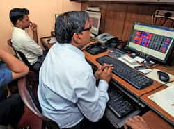 Brokers watch the market trend at Kolkata Stock Exchange in Kolkata during presentation of the union budget by finance minister Pranab Mukherjee. (PTI Photo by Swapan Mahapatra) Other side of budget