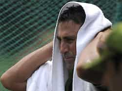 Pakistan cricketer Younis Khan uses a towel during a team training session at The Sher-e-Bangla National Cricket Stadium in Dhaka. AFP Photo/Munir uz Zaman Who will rule Asia?