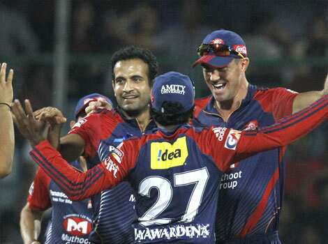 Delhi Daredevils team members celebrate the wicket of Mumbai Indians