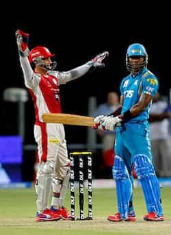 Kings XI Punjabs captain Adams Gilchrist and Pune Warriors player Marlon Samuels in action during the match between Pune Warrior India and Kings XI Punjab at Subrata Roy Sahara Stadium, Pune. (HT Photo/Sattish Bate) Pune Warrior India beat Kings XI Punjab