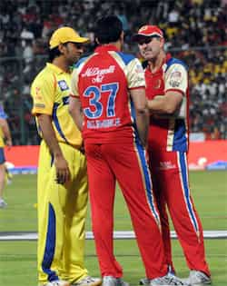 MS Dhoni and Anil Kumble interact after heavy rain washed away the match between Royal Challengers Bangalore and Chennai Super Kings at M Chinnaswamy Stadium in Bangalore. Rain ruins RCB vs CSK match